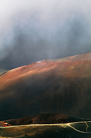 The often present clouds in the crater of HALEAKALA NATIONAL PARK on Maui in Hawaii add a surreal ambiance to the experience