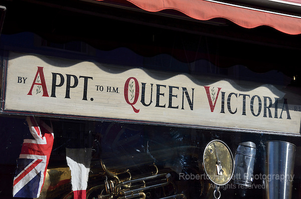 By Appointment to Her Majesty Queen Victoria sign in a shop window