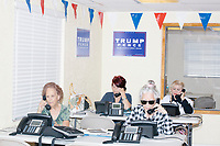 Zoila Oliva, 76, (front right), Gina Gomez, 76, (front left), Blanca Vrotsos, 62, (rear right), and Inez Yimoc, 55, volunteer in the phone bank at the Donald Trump campaign office in Hialeah, Miami, Florida.