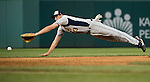 Short stop Rep. Tim Ryan, D-Ohio, dives for a ground ball during the Roll Call Congressional Baseball Game on Wednesday, June 25, 2014. (Photo By Bill Clark/CQ Roll Call)