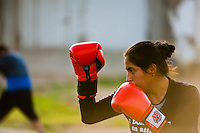 A Peruvian girl practices defense while training in the outdoor boxing school at the Telmo Carbajo stadium in Callao, Peru, 4 April 2013.