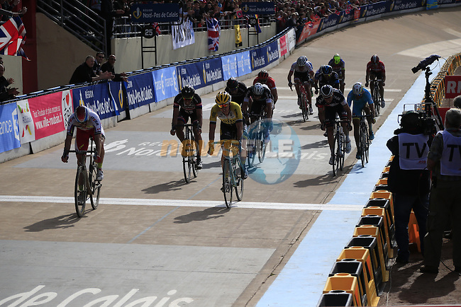 The chase group of riders cross the finish line in the famous Roubaix Velodrome at the end of the 113th edition of the Paris-Roubaix 2015 cycle race held over the cobbled roads of Northern France. 12th April 2015.<br /> Photo: Eoin Clarke www.newsfile.ie