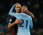 Pablo Zabaleta of West Ham United hugs David Silva of Manchester City during the premier league match at the Etihad Stadium, Manchester. Picture date 3rd December 2017. Picture credit should read: Andrew Yates/Sportimage