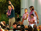 Washington, DC - June 25, 2009 -- United States President Barack Obama and his family Malia Obama, Michelle Obama and Sasha Obama host a luau for members of Congress and their families on the South Lawn of the White House June 25, 2009 in Washington, DC. In a celebration of the president's home state, the South Lawn was decorated with tiki torches and palm huts and the meal prepared by famous Hawaiian chef Alan Wong..Credit: Chip Somodevilla - Pool via CNP