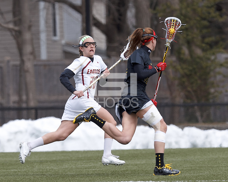 University of Maryland midfielder Beth Glaros (20) on the attack as Boston College midfielder Kate McCarthy (20) closes..University of Maryland (black) defeated Boston College (white), 13-5, on the Newton Campus Lacrosse Field at Boston College, on March 16, 2013.