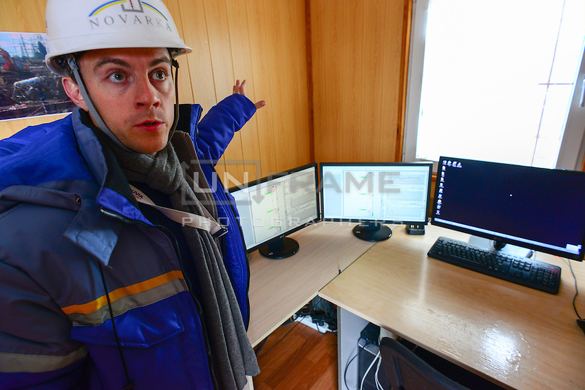 An employee of Novarka company seen in control room of Air monitoring systems set between 4th reactor of Chernobyl Power plant and construction site to provide constant monitoring and alarm in case of radioactive pollution.
