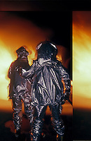 Airport firefighters in fire resistant protective suits.