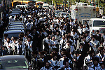 BROOKLYN - APRIL 29, 2006:  Members of Satmar community supporting Rabbi Aaron Teitelbaum walk down Lee Avenue after services in a tent synagogue on a baseball field in a park at Taylor Street and Lee Avenue on Williamsburg on April 29, 2006 in Brooklyn.. (Photograph Michael Nagle)