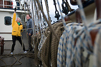 Hebrides, Scotland, May 2010. Burning muscles from pulling the ropes to raise the sails and climbing to the top of the mast on iny rope ladders. Dutch Tallship Thalassa sails between the islands along the Scotish west coast in search of the quality single malt whisky that is produced by the many distilleries. Photo by Frits Meyst/Adventure4ever.com