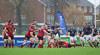 Mark Bright (Captain) of London Scottish heads forward under pressure during the Greene King IPA Championship match between London Scottish Football Club and Jersey at Richmond Athletic Ground, Richmond, United Kingdom on 7 November 2015. Photo by Andy Rowland.