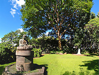 A stone statue creates a feeling of serenity at lush Foster Botanical Gardens in Honolulu.