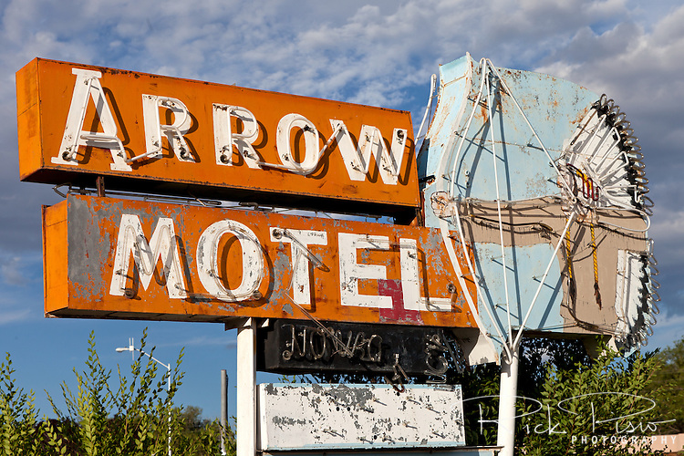 The faded and broken neon sign for the closed Arrow Motel in Espanola, New Mexico, continues to attract the road travelers attention.