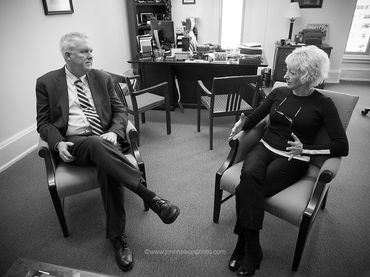 Council member Tommy Wells meets with his chief of staff Linda O'Brien in his office in Washington, DC.