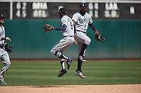 OAKLAND, CA - AUGUST 15:  Dee Gordon #9 and Denard Span #4 of the Seattle Mariners celebrate after the game against the Oakland Athletics at the Oakland Coliseum on Wednesday, August 15, 2018 in Oakland, California. (Photo by Brad Mangin)
