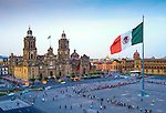 The Mexican flag flies over the Zocalo, the main square in Mexico City.  The Metropolitan Cathedral faces the square, also referred to as Constitution Square.