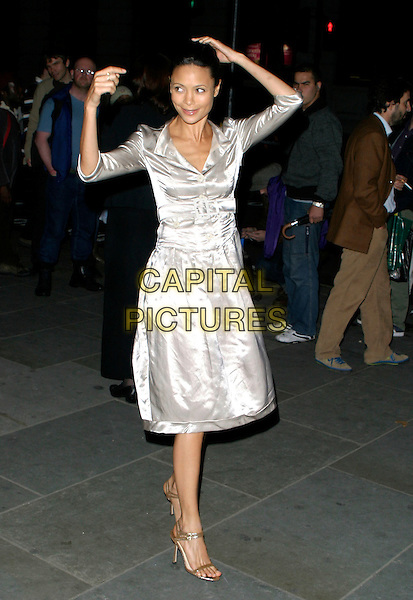 THANDIE NEWTON.The VIP private viewing of portraits by artist David Hockney at the National Portrait Gallery, London, UK..October 11th, 2006 .Ref: AH.full length dress silver arms in air.www.capitalpictures.com.sales@capitalpictures.com.©Adam Houghton/Capital Pictures.