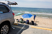 Sections of the parking lot have been repaired while other sections have been closed off because of severe damage from storms earlier this year at Herring Cove Beach in the Cape Cod National Seashore outside of Provincetown, Mass., USA, seen here on Fri., July 1, 2016. Other beaches in the area have also experienced coastal retreat.
