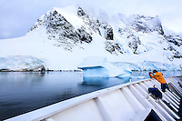 "Photographing from the deck of the ""Sea Spirit"" in the Lemaire Channel on the coast of the Antarctic Peninsula."