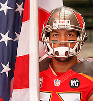 TAMPA, FL - NOVEMBER 9: Wide Receiver Vincent Jackson #83 of the Tampa Bay Buccaneers prepares to carry the American flag out of the tunnel during introductions of during the game against the Atlanta Falcons at Raymond James Stadium on November 9, 2014, in Tampa, Florida. The Buccaneers lost 27-17. (photo by Matt May/Tampa Bay Buccaneers)