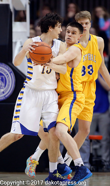 RAPID CITY, SD - MARCH 18, 2017 -- Johah Dohrer #22 of Aberdeen Central reaches on Joey Messler #15 of Sioux Falls O'Gorman during the 2017 South Dakota State Class AA Boys Basketball Championship game Saturday at Barnett Arena in Rapid City, S.D.  (Photo by Dick Carlson/Inertia)