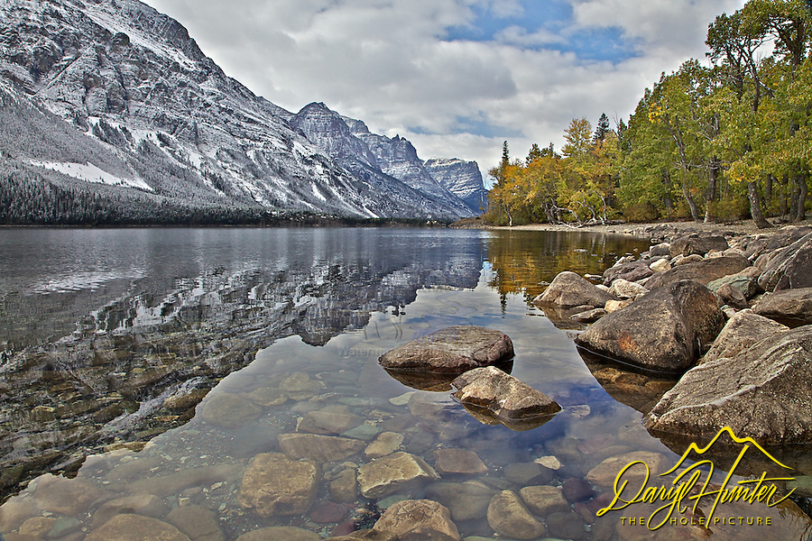 Mountain reflections in St Marys Lake on a fine Autumn day in Glacier National Park.