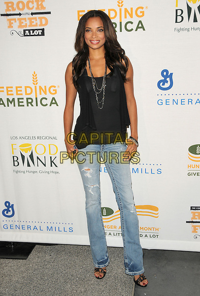 "ROCHELLE AYTES .at The ""Rock a Little, Feed A Lot"" benefit concert to support the L.A. Regional Food Bank & Feeding America held at Club Nokia in Los Angeles, California, USA, September 29th 2009.        .full length top jeans ripped torn destroyed open toe sandals black necklace smiling .CAP/DVS.©Debbie VanStory/RockinExposures/Capital Pictures."