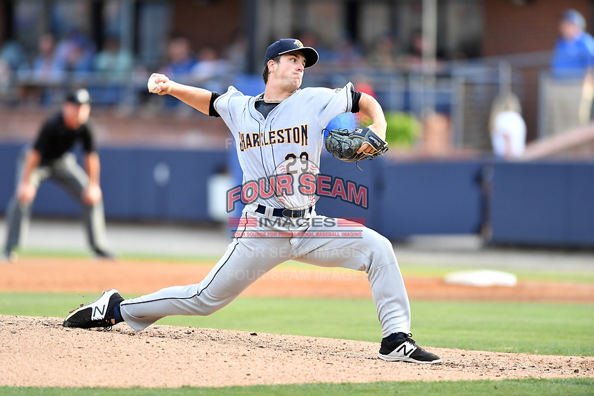 Charleston RiverDogs starting pitcher Austin DeCarr (29) delivers a pitch during a game against the Asheville Tourists at McCormick Field on July 6, 2017 in Asheville, North Carolina. The Tourists defeated the RiverDogs 13-9. (Tony Farlow/Four Seam Images)