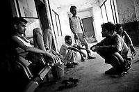 Tuberculosis patients gathered in a corridor in the mens ward at the Rajan Babu TB hospital in New Delhi, India.