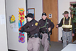 Sheriff personnel scanning rooms in a church for a shooter hiding during an exercise
