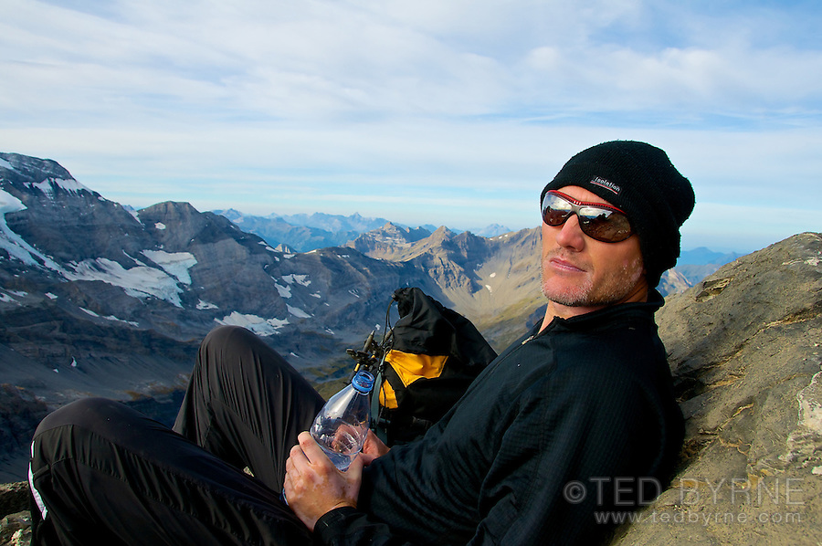 Male hiker taking a water break high in the Swiss Alps