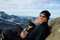 Male hiker taking a water break high in the Swiss Alps