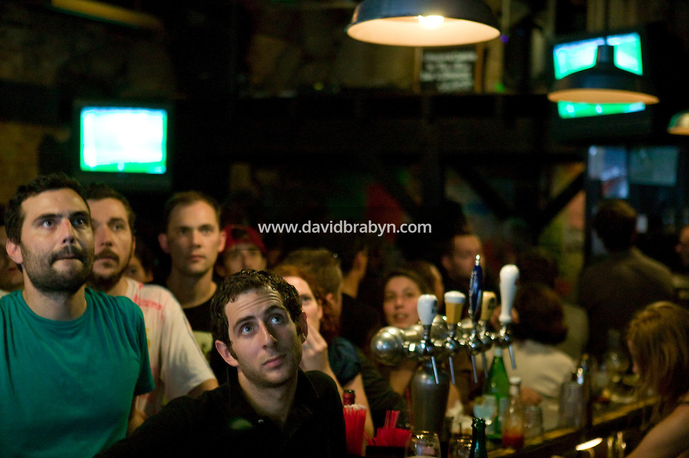 Supporters of the French rugby team watch  France's victory World Cup quarter final game against New-Zealand on a television screen (not pictured) in a French bar in the Lower East Side of Manhattan in New York, USA, 6 September 2007.