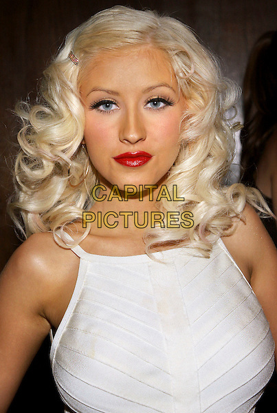"CHRISTINA AGUILERA.Celebrates the launch of her new album ""Back to Basics"",.New York City, New York, USA,.15 August 2006..portrait headshot red lipstick cream white dress eyes to camera hair slide grip clip diamante eye contact eyes to camera.Ref: ADM/JL.www.capitalpictures.com.sales@capitalpictures.com.©Jackson Lee/AdMedia/Capital Pictures."