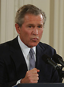 United States President George W. Bush conducts a formal press conference from the East Room of the White House in Washington, DC on April 13, 2004.<br /> Credit: Ron Sachs / CNP