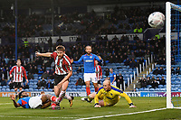 Ellis Harrison of Portsmouth is tackled by Andy White of Altrincham during Portsmouth vs Altrincham, Emirates FA Cup Football at Fratton Park on 30th November 2019