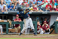 Michigan Wolverines second baseman Ako Thomas (4) swings the bat during Game 6 of the NCAA College World Series against the Florida State Seminoles on June 17, 2019 at TD Ameritrade Park in Omaha, Nebraska. Michigan defeated Florida State 2-0. (Andrew Woolley/Four Seam Images)