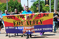 "Phoenix, Arizona (March 29, 2014) - Demonstrators leading the march hold a sign that reads: ""Get the memo Arizona, Equality is not a gay thing! It's a human thing!"". Photo by Eduardo Barraza © 2014"