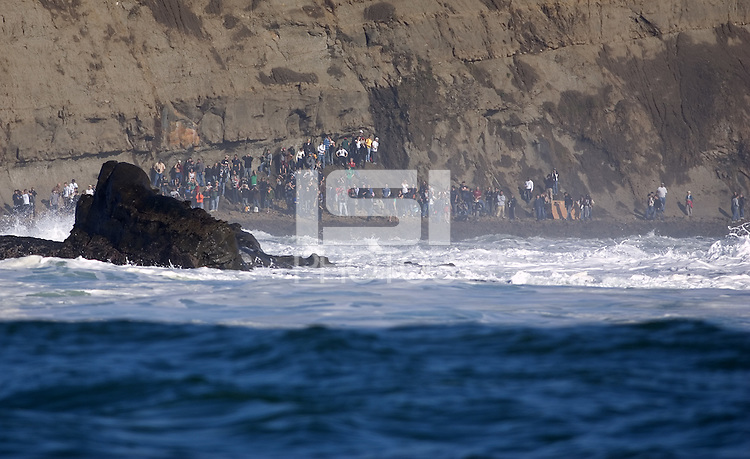 2008 Mavericks spectators viewing from the cliffs during the Semi Finals at the 2008 Mavericks contest held at Pillar Point, Half Moon Bay, Calif., Saturday, January 12, 2008.