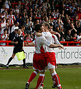 Scott Laird of Stevenage Borough celebrates with David Bridges (r) after scoring from the penalty spot for their second goal during the Blue Square Premier match between Stevenage Borough and Forest Green Rovers at the Lamex Stadium, Broadhall Way, Stevenage on Saturday 10th April, 2010 ..© Kevin Coleman 2010