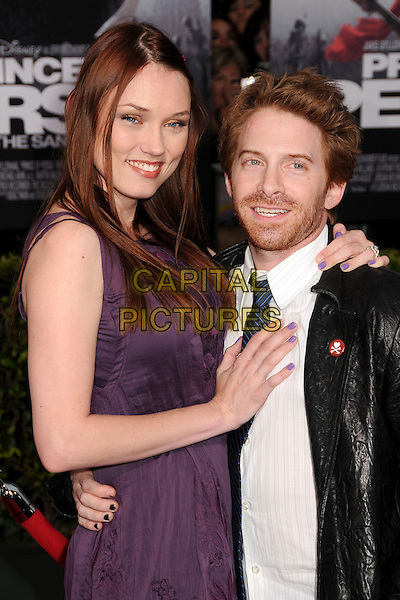 """CLARE GRANT & SETH GREEN.""""Prince Of Persia: The Sands Of Time"""" Los Angeles Premiere held at Grauman's Chinese Theatre, Hollywood, California, USA..May 17th, 2010.half length shirt tie beard facial hair blue leather arm around waist nail varnish polish black white purple dress couple tall short.CAP/ADM/BP.©Byron Purvis/AdMedia/Capital Pictures."""