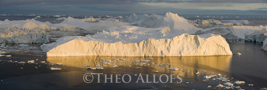 Large icebergs at midnight, end of June, mid summer night, panorama; Disko Bay, Greenland