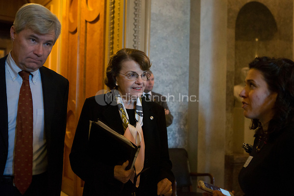 United States Senator Dianne Feinstein (Democrat of California) and US Senator Sheldon Whitehouse (Democrat of Rhode Island) exit the US Senate chamber in the US Capitol after a procedural vote on Friday, December 1, 2017. <br /> Credit: Alex Edelman / CNP /MediaPunch
