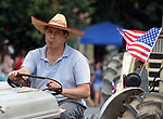 Members of the Saugerties Vintage Tractor Club, seen in the Independence Day Parade in Village of Saugerties, NY, on Tuesday, July 4, 2017. Photo by Jim Peppler. Copyright/Jim Peppler-2017.