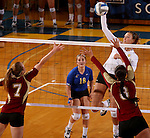 BROOKINGS, SD - OCTOBER 3:  Wagner Larson #11 from South Dakota State University looks to get a kill past Nola Basey #7 and Erica Denney #8 from Denver in the fourth game of their match Friday night at Frost Arena. (Photo/Dave Eggen/Inertia)