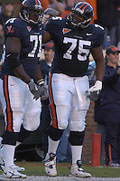12 November 2005: Virginia linemen Branden Albert (71) and Eugene Monroe (75) celebrate after a rushing TD..The Virginia Cavaliers defeated the Georgia Tech Yellow Jackets 27-17 at Scott Stadium in Charlottesville, VA.