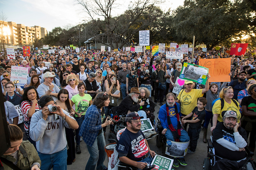 AUSTIN, TEXAS - Anti-Trump protesters gather at Vic Mathias Shores prior to marching throughout downtown Austin following the inauguration of Donald Trump as the 45th president of the United States. Friday January 20, 2017. DAN HERRON / HERRONSTOCK<br /> <br /> Use of this image in advertising or for promotional purposes is prohibited.<br /> <br /> Editorial Credit: Dan Herron / Herronstock Editorial.