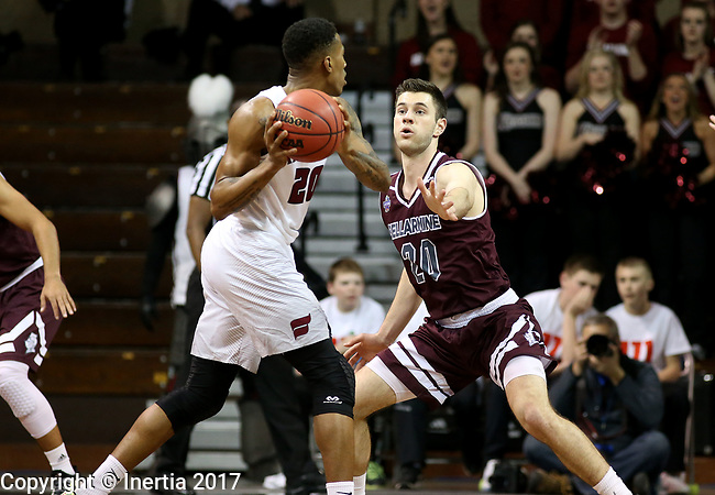 SIOUX FALLS, SD: MARCH 23: George Knott #20 from Bellarmine applies pressure to Thomas Wimbush #20 from Fairmont State during the Men's Division II Basketball Championship Tournament on March 23, 2017 at the Sanford Pentagon in Sioux Falls, SD. (Photo by Dave Eggen/Inertia)