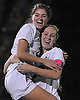 Massapequa No. 28 Ashley Cosenza, left, and No. 23 Skylar Vitiello celebrate after their team's 3-0 win over West Islip in the varsity girls' soccer Class AA Long Island Championship at Adelphi University on Saturday, November 7, 2015. <br /> <br /> James Escher