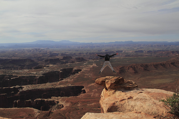 Man BASE jumping in Canyonlands National Park; Utah, USA. .  John offers private photo tours in  Canyonlands National Park and throughout Utah and Colorado. Year-round.