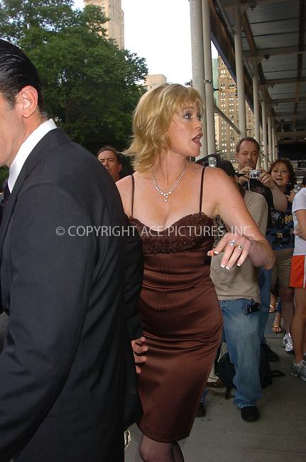 WWW.ACEPIXS.COM . . . . .  ....June 28, 2006, New York City. ....Antonio Banderas and wife Melanie Griffith leave the Ritz Carlton hotel. ......Please byline: AJ Sokalner - ACEPIXS.COM..... *** ***..Ace Pictures, Inc:  ..(212) 243-8787 or (646) 769 0430..e-mail: info@acepixs.com..web: http://www.acepixs.com